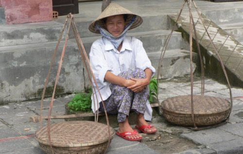 Woman with two baskets